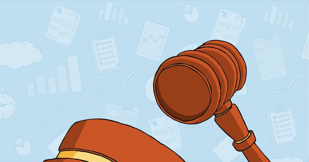 A gavel is seen on a blue background. It is a legal reference.