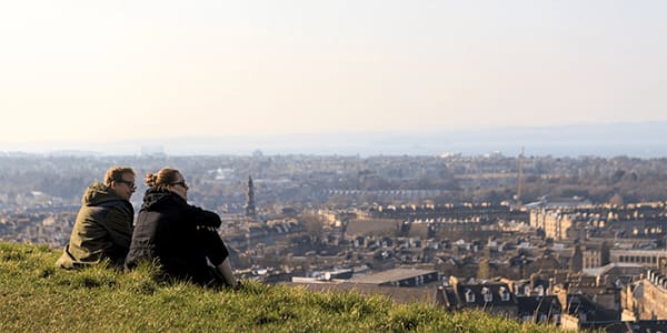 photo of people sitting on Calton Hill looking out over Edinburgh