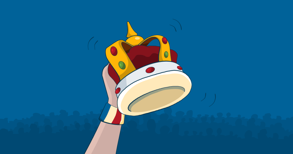 A hand holds a crown in the air